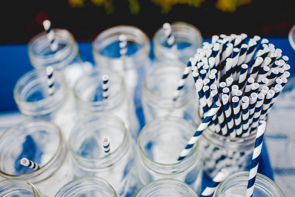 Mason jars with reusable blue and white straws