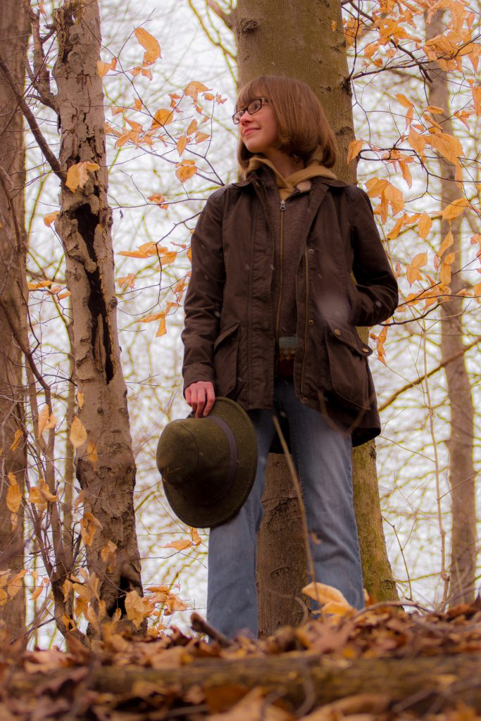 Profile photo of Iris standing in the woods